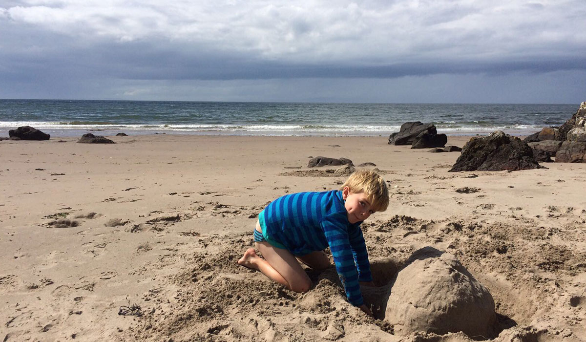 child-playing-at-beach